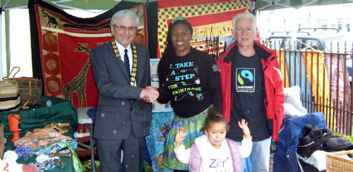 World Fair Trade Day 2015 stall at Cornwall House. Welcoming the Mayor of Monmouth, Graham Pritchard, with Love Zimbabwe and Hands Around the World.